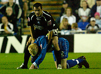 Photo: Daniel Hambury.<br /> Reading v Swansea. Carling Cup.<br /> 23/08/2005.<br /> Reading's Dave Kitson and Swansea's Kevin McLeod in a stra<br /> nge position.