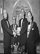 John Player Tops of the Town Final..1980-06-01.1st June 1980.01-06-1980.06-01-80..Photographed at Gaiety Theatre, Dublin....Irish Distillers Variety Group emerge as winner in the John Player Tops of the Town Final. They beat Waterford Banks and Finance by two marks. ..From Left:..Bobby Cooke, Group leader of the Irish Distillers Variety Group holding the Irish National Final Trophy...Alderman William Cummiskey, Lord Mayor of Dublin...Frank O'Reilly, Chairman of John Player, presenting the National Final Trophy...Alderman Stephen Rogers, Mayor of Waterford..