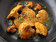 Cooked wiild organic Pied de Mouton Mushrooms (hydnum repandum) or hedgehog mushrooms cooked in butter and herbs