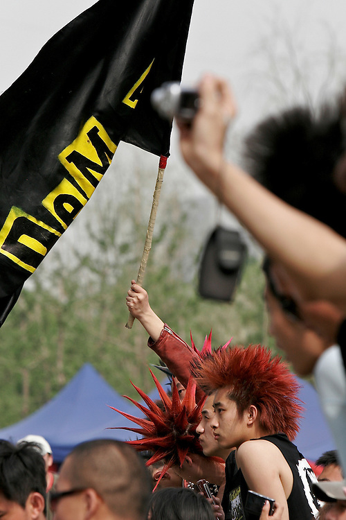Fans of the Punk band Demerit wait for the show to begin at Midi Music Festival in Beijing China 2007.  Midi is a Chinese alternative music concert that lasts 4 days and features Chinese and international bands.