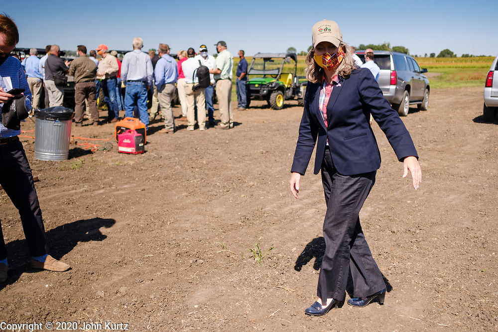 03 SEPTEMBER 2020 - RADCLIFFE, IOWA: US Senator JONI ERNST (R-IA) walks through the parking lot while campaigning for reelection at a farm event in central Iowa Thursday. She accompanied Sonny Perdue, the US Secretary of Agriculture, who made a secretarial disaster declaration for 42 counties in central Iowa. Perdue was accompanied by Governor Kim Reynolds Ernst. The secretarial disaster declaration frees up more federal funds, from the Department of Agriculture, to help in recovery from the derecho storm that wiped out about one-third of Iowa's corn crop on Monday, August 10, 2020. Many Iowa farmers are still rebuilding lost buildings or plowing under lost crops.       PHOTO BY JACK KURTZ