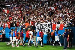 March 23, 2018 - Miami Gardens, Florida, USA - Peruvian fans cheer as their team exits the field of a FIFA World Cup 2018 preparation match between the Peru National Soccer Team and the Croatia National Soccer Team at the Hard Rock Stadium in Miami Gardens, Florida. (Credit Image: © Mario Houben via ZUMA Wire)