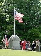 Hamptonburgh, NY -  People salute the flag during Memorial Day ceremonies at Hamptonburgh Cemetery  on May 25, 2009.