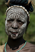 Woman with face painted and cut lip, Mursi Tribe, Mago National Park, Lower Omo Valley, Ethiopia, portrait, person, one, tribes, tribal, indigenous, peoples, Southern, ethnic, rural, local, traditional, culture, primitive,