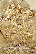 Chaldean Assyrian relief sculpture slab from the northwest palace of King Ashurnasirpal II of a Genie standing. 881-859 B.C form Nimrud or Nimrut ( Kalhu or Kalah). Istanbul Archaeological exhibit Inv. No. 6. .<br /> <br /> If you prefer to buy from our ALAMY PHOTO LIBRARY  Collection visit : https://www.alamy.com/portfolio/paul-williams-funkystock/ancient-assyria-antiquities.html  Type -    Istanbul    - into the LOWER SEARCH WITHIN GALLERY box to refine search by adding background colour, place, museum etc<br /> <br /> Visit our ANCIENT WORLD PHOTO COLLECTIONS for more photos to download or buy as wall art prints https://funkystock.photoshelter.com/gallery-collection/Ancient-World-Art-Antiquities-Historic-Sites-Pictures-Images-of/C00006u26yqSkDOM