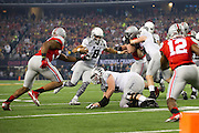 Marcus Mariota #8 of the Oregon Ducks scrambles against the Ohio State Buckeyes during the College Football Playoff National Championship Game at AT&T Stadium on January 12, 2015 in Arlington, Texas.  (Cooper Neill for The New York Times)
