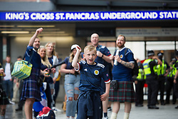 © Licensed to London News Pictures.  18/06/2021. London, UK. Scottish football supporters arrive at Kings Cross Station in central London ahead of their EURO 2020 match against England at Wembley this evening. Photo credit: Marcin Nowak/LNP