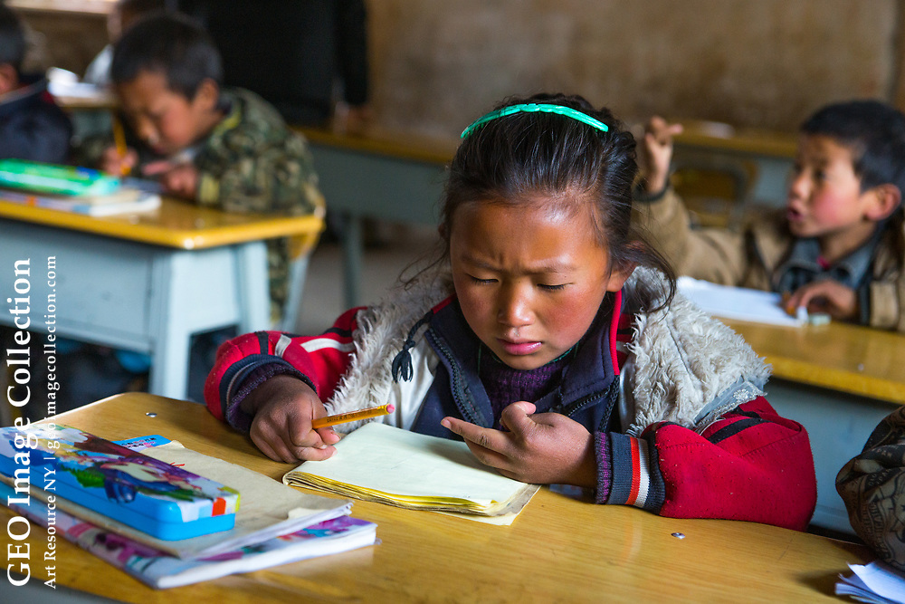 Bazhu Village elementary school, preschool to 5th grade. A Tibetan village, kids come from all over Tacheng area to learn Han Chinese from Naxi teachers. Yunnan, China
