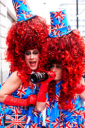 LONDON, UK  29/04/2011. The Royal Wedding of HRH Prince William to Kate Middleton. Despite a massive security operation with 5,000 police on duty the only bag searches taking place are being conducted by a private security firm stopping people taking food and drink into Trafalgar Square simply to allow the vendors in the square to sell more. Some, like those pictured in fancy dress and large wigs would rather drink their champagne on the spot than hand it over. Photo credit should read CLIFF HIDE/LNP.