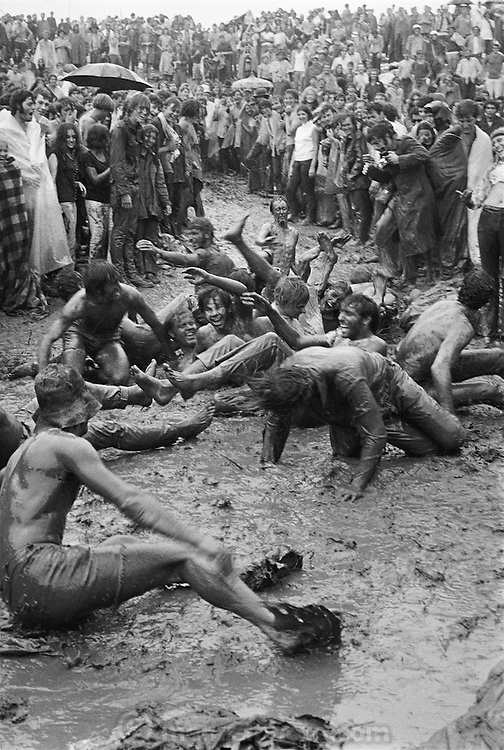 Woodstock Rock Festival fans sliding down a muddy hill at the Woodstock rock festival at Max Yasgur's 600 acre farm, in the rural town of Bethel, NY, on the weekend of August 16-18, 1969..