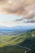 An Aerial view of the Park Road winding through the vast, Denali National Park, Alaska.