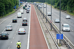 © London News Pictures. 16/07/2012. London, UK. An An empty M4 Olympic lane on July 16, 2012 which opened today. Journeys for Olympic officials and athletes into central London are intended to be eased by the Olympic lane on the M4 motorway, which is the main route in to central London from Heathrow airport. Photo credit: Ben Cawthra/LNP.