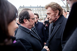 File photo : French President Francois Hollande greets singer Johnny Hallyday during a national tribute to the victims of the January and November 2015 terror attacks, at Place de la Republique square in Paris, France on January 9, 2016. France's biggest rock star Johnny Hallyday has died from lung cancer, his wife says. He was 74. The singer - real name Jean-Philippe Smet - sold about 100 million records and starred in a number of films. Photo by Denis Allard/Pool/ABACAPRESS.COM