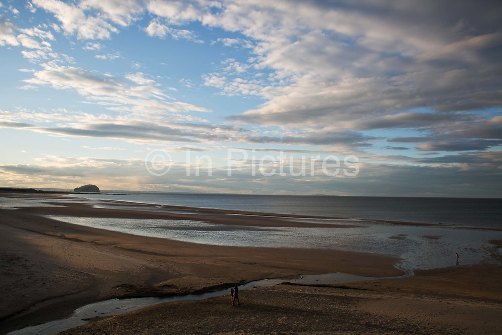 Sunset over Tyninghame beach near North Berwick in Scotland 31st of July 2016. Its summer time and sun set is late and the beach is near empty.