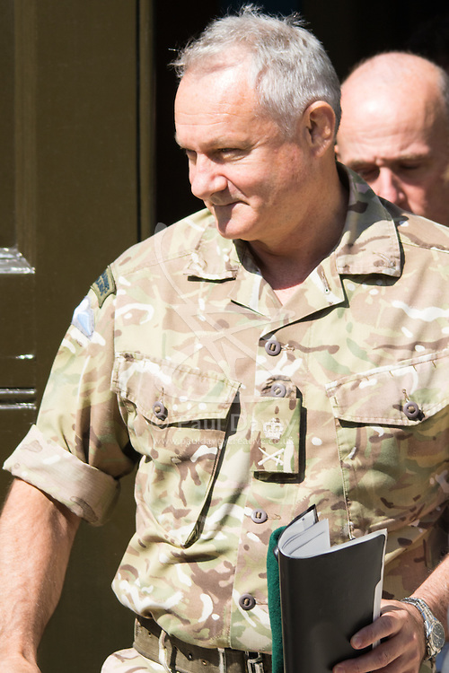 Whitehall, London, July 31st 2015. A senior military officer leaves the Cabinet Office following a COBRA meeting to discuss the ongoing reugee crisis in Calais, which is throttling services through the channel tunnel, one of the UK's most important lifelines.