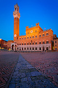 The Torre del Mangia is a tower in Siena, in the Tuscany region of Italy. Built in 1325-1344, it is located in the Piazza del Campo, Siena's premier square, adjacent to the Palazzo Pubblico (Town Hall). When built it was one of the tallest secular towers in mediaeval Italy.