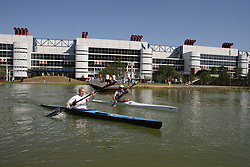 Stock photo of two men kayaking in the pond