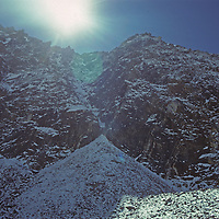The sun glows over the west side of Changri La (Pass,) a difficult descent.
