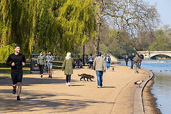 Licensed to London News Pictures. 20/04/2021. London, UK. Members of the public enjoy the warm sunshine again in Hyde Park, London this morning a week after the easing of Covid-19 restrictions. A mini heatwave has hit the UK this week with temperatures reaching over 18c in London and the South East yesterday. Photo credit: Alex Lentati/LNP