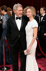 Harrison Ford and Calista Flockhart arriving at the 86th Academy Awards held at the Dolby Theatre in Hollywood, Los Angeles, USA.