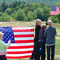 SHANKSVILLE, PA -  SEPTEMBER 11:    Visitors to the Flight 93 Temporary Memorial leaves America flags and oher remembrances along the fence of the western overlook of the crash site on the ninth anniversary of the crash of Flight 93 on September 11, 2010 in Shanksville, Pennsylvania.  (Photo by Archie Carpenter/Getty Images)