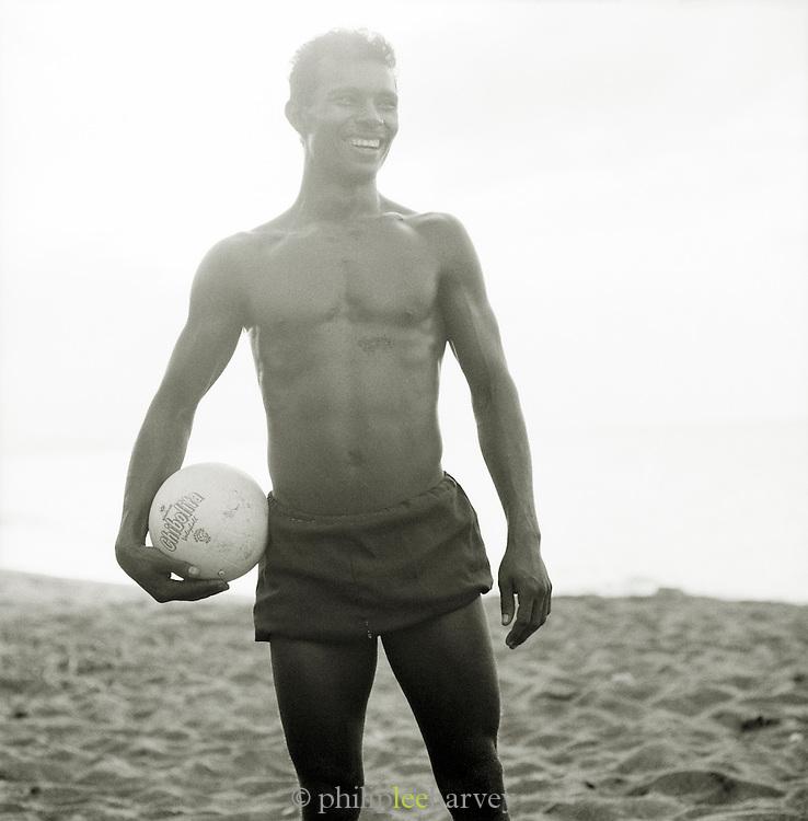 Man playing beach volleyball, Cuba