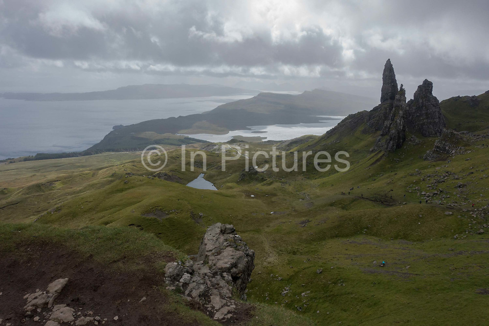 The Old Man of Storr on the 3rd September 2016 on the Isle Of Skye in Scotland in the United Kingdom. The 'Old Man' is a large pinnacle of rock that stands high and can be seen for miles around. Forming part of the Trotternish ridge, the Storr was created by a massive ancient landslide, and has become a popular walking and tourist destination.