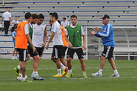Football - Real Madrid Training for St. Louis Game against Inter Milan.  The Real Madrid team held a practice session on Thursday August 8, 2013 in St. Louis, Missouri, USA at the Robert Hermann Stadium located on the campus of St. Louis University in St. Louis. Head coach Carlo Ancelloti (right) claps as the team wraps up a drill.