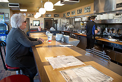 Kim Kaseta waits for her pattie melt while sitting at the counter at the Waffle House in Brookhaven Monday, April 27, 2020. Photo by Steve Schaefer/Atlanta Journal-Constitution/TNS/ABACAPRESS.COM