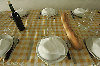 table set with wine and baguette for wine harvesters at Chateau Petrus, Pomerol, near Bordeaux