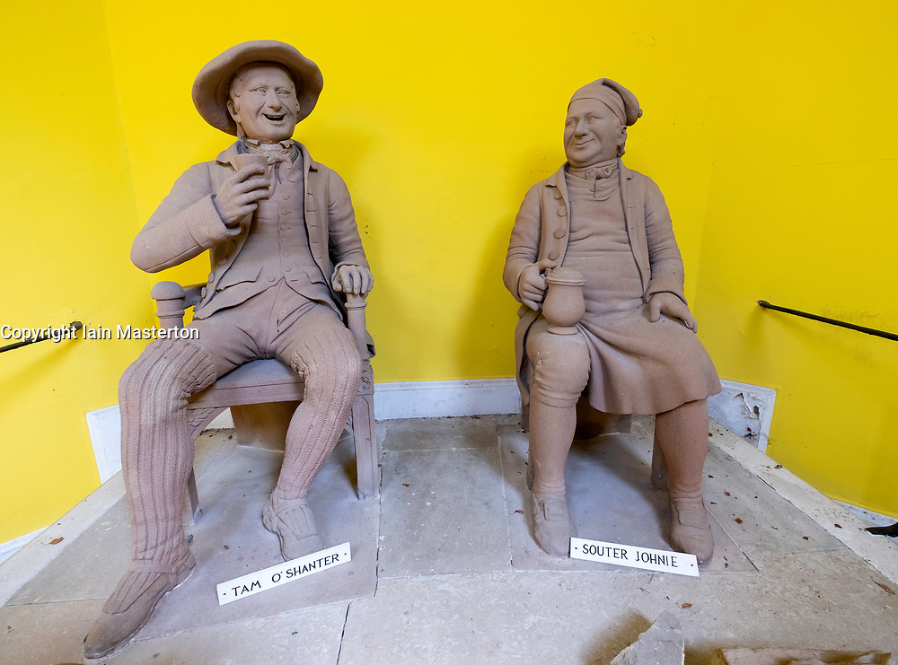 Statues of Tam O Shanter and Souter Johnie at Burns Memorial Gardens in Alloway, Ayrshire, Scotland, UK.