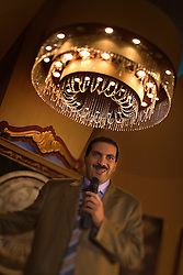 Amr Khaled, an Islamic televangelist, addresses his followers at a Life Makers gathering inside a local wedding hall, Alexandria, Egypt, Dec. 24. 2005. The former accountant with the Western-style suit and soft voice had previously been asked to leave Egypt as his revival gained strength. As a result he started preaching on several television shows, turning him into an international celebrity.