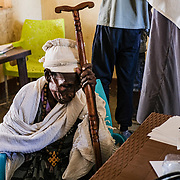 HAMDAYET, SUDAN - DECEMBER 6, 2020: A 70-year-old refugee from the Tigray region of Ethiopia receives basic medical attention from an understaffed clinic run by the Sudanese Ministry of Health with assistance from Doctors Without Borders located in the east Sudanese border village of Hamdayet on December 6, 2020 in Hamdayet, Sudan. Last week, the Ethiopian government declared victory in its nearly monthlong battle with the Tigray People's Liberation Front (TPLF), which sent 45,000 people fleeing to Sudan and displaced thousands more within the Tigray Region. In recent days, Ethiopian forces have prevented even more people from crossing the border into Sudan, while a TPLF spokesman said that fighting had continued outside of Mekelle, Tigray's regional capital. (Photo by Byron Smith/Getty Images)