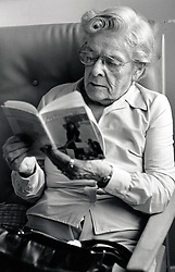 Portrait of an elderly woman reading, Nuffield House Day Centre, Nottingham, UK 1985