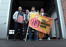Licensed to London News Pictures. 25/09/2013.Tynemouth, North Tyneside, UK, Members of the Fire Brigades Uinion walk out on strike at the stroke of noon at Tynemouth Fire Station, part of Tyne & Wear Fire & Rescue Service. Photo credit: Adrian Don/LNP