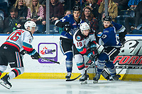 KELOWNA, BC - JANUARY 8: Sean Gulka #17 and Kaid Oliver #34 of the Victoria Royals check Ethan Ernst #19 of the Kelowna Rockets  at Prospera Place on January 8, 2020 in Kelowna, Canada. (Photo by Marissa Baecker/Shoot the Breeze)
