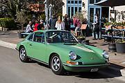 Leura Garage Cafe Restaurant Bar, The Blue Mountains, NSW, Australia.A green 911T Porsche parked outside.