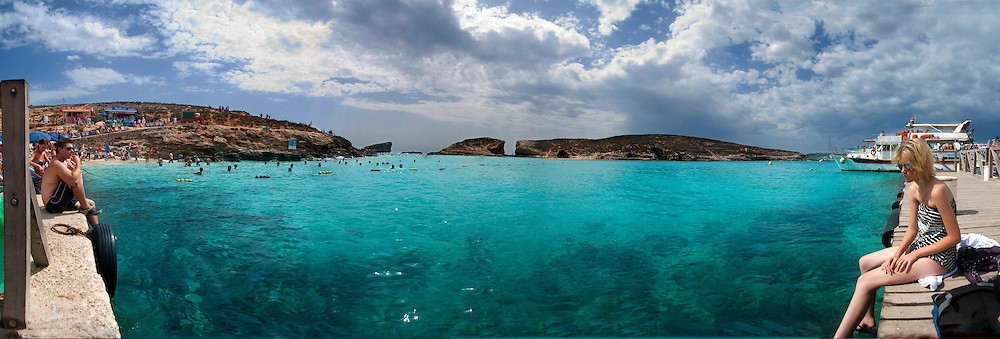 Malta, Panoramic view of Holiday makers on a Mediterranean Beach