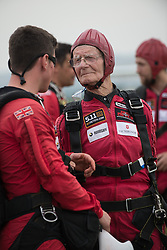 © Licensed to London News Pictures. 25/08/2016. <br /> <br /> Pictured: D-Day veteran Fred Glover talks to a member of the British Army's Red Devils parachute display team before his jump. <br /> <br /> Fred Glover and Ted Pieri, two D-Day veterans who are both 90 years old have parachuted into Sarum Airfield, Wiltshire on Thursday 25th August 2016, 72 years after D-Day having earlier in the month parachuted into Merville Battery in France.<br /> <br /> Photo credit should read Max Bryan/LNP