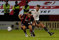 Photo: Leigh Quinnell.<br /> AFC Bournemouth v Bristol City. Coca Cola League 1. 26/09/2006. Bristols Louis Carey gets to grips with Bournemouths James Hayter.