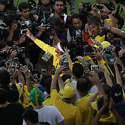 Football - Olympics: Day 15  Neymar #10 of Brazil takes a photographer with fans doing victory celebrations after the Brazil Vs Germany Men's Football Gold Medal Match at Maracana on August 20, 2016 in Rio de Janeiro, Brazil. (Photo by Tim Clayton/Corbis via Getty Images)