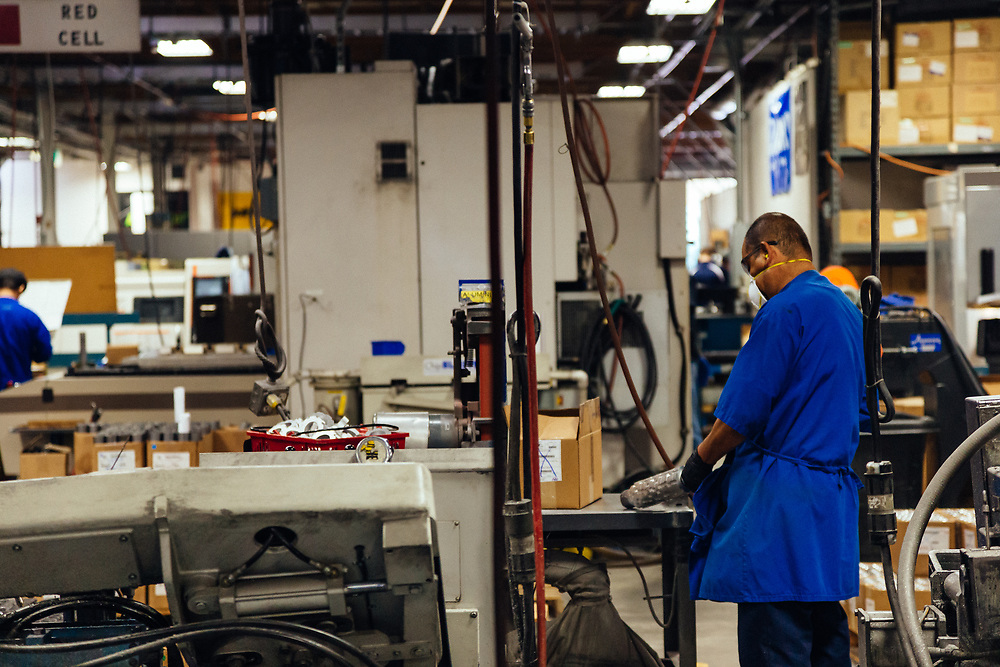 A machinist finalizes parts for the assembly plant at Fox Racing.