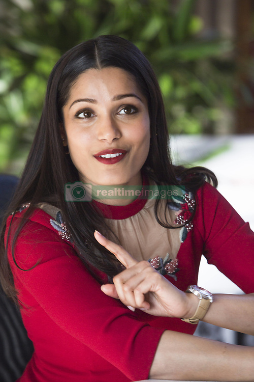 March 23, 2017 - Hollywood, California, U.S. - FREIDA PINTO stars in the TV mini series Guerrilla. Freida Selena Pinto (born October 18, 1984) is an Indian actress who has appeared mainly in American and British films. She was born and raised in Mumbai, India, and decided when she was young that she would become an actress. As a student at St. Xavier's College, Mumbai, she took part in amateur plays. After graduation, she briefly worked as a model and then as a television presenter. Pinto rose to prominence through the 2008 British drama Slumdog Millionaire, her first appearance in a film. She won the Breakthrough Performance Award at the Palm Springs International Film Festival and was nominated for various awards at the British Academy Film Awards, the MTV Movie Awards and the Teen Choice Awards. She has appeared in several American and British productions, often playing supporting roles. Her biggest commercial success came with the 2011 science fiction film Rise of the Planet of the Apes. Pinto received major attention for portraying the title character in Trishna (2011). Her performance in the biographical drama Desert Dancer (2014) received critical acclaim. Jungle Book (2018), Love Sonia (2017), Guerrilla (TV Mini-Series 2017), Yamasong: March of the Hollows (2017) (Credit Image: © Armando Gallo via ZUMA Studio)