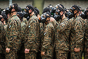 US Marine recruits prepare to enter the gas chamber during bootcamp January 13, 2014 in Parris Island, SC.