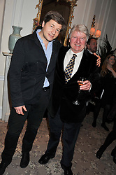 Left to right, LEO JOHNSON and his father STANLEY JOHNSON at the launch of Whole World Water at The Savoy Hotel, London on 22nd March 2013.