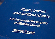 Blue recycling bin for plastic bottles and cardboard only, Wiltshire Council, England, UK