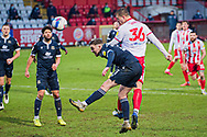 GOAL 2-2 Stevenage forward Luke Norris (36) beats Morecambe defender Ryan Cooney (21) to the ball and heads it into the bottom corner to level the game during the EFL Sky Bet League 2 match between Stevenage and Morecambe at the Lamex Stadium, Stevenage, England on 6 February 2021.