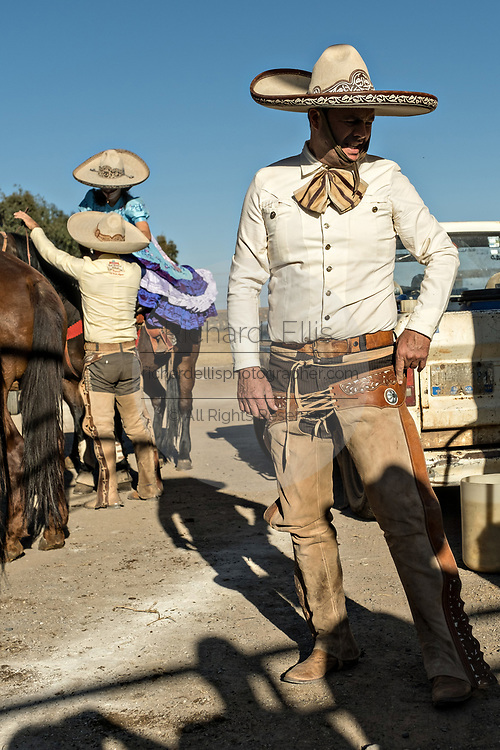 Juan Franco, Sr., finishes dressing in the traditional Charro costume as he readies for a family practice session in the Jalisco Highlands town of Capilla de Guadalupe, Mexico. The Franco family has dominated Mexican rodeo for 40-years and has won three national championships, five second places and five third places.