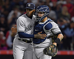 April 29, 2018 - Anaheim, CA, U.S. - ANAHEIM, CA - APRIL 29: New York Yankees pitcher Artoldes Chapman (54) and catcher Gary Sanchez (24) on the field after the Yankees defeated the Los Angeles Angels of Anaheim 2 to 1 for the series sweep in a game played on April 29, 2018 at Angel Stadium of Anaheim in Anaheim, CA. (Photo by John Cordes/Icon Sportswire) (Credit Image: © John Cordes/Icon SMI via ZUMA Press)