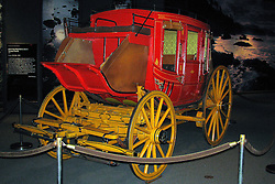 18 October 2010: A stagecoach displays the luxurious method of travel to the west.  Gateway Westward Museum,St. Louis Missouri